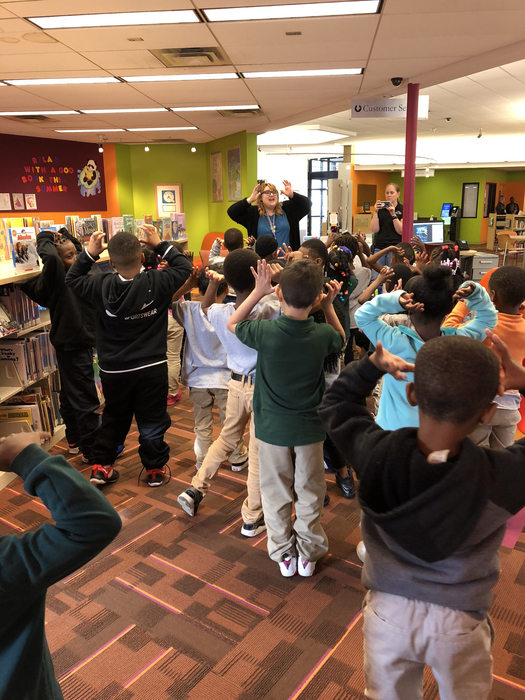 Our students doing the moose song at the library!